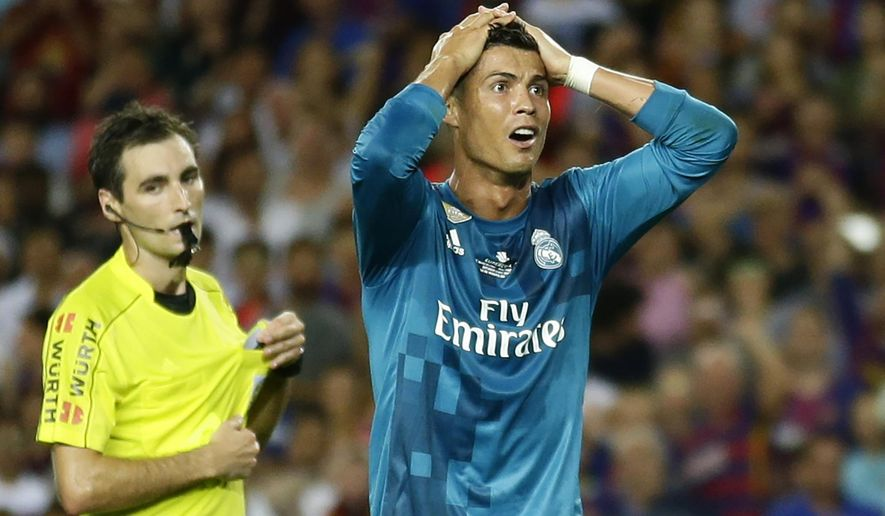 Real Madrid's Cristiano Ronaldo, right, reacts after Referee Ricardo de Burgos shows a second yellow card during the Spanish Supercup, first leg, soccer match between FC Barcelona and Real Madrid at the Camp Nou stadium in Barcelona, Spain, Sunday, Aug. 13, 2017. Cristiano Ronaldo was banned for five games on Monday after shoving a referee following his red card for diving in Real Madrid's 3-1 win over Barcelona in the season-opening Spanish Super Cup. (AP Photo/Manu Fernandez)