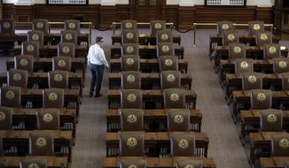 "Chris Currens, who works in the office of the sergeant-at-arms in the Texas House, walks through an empty chamber, Wednesday, Aug. 16, 2017, in Austin, Texas. The Texas Legislature adjourned Tuesday and a Texas ""bathroom bill"" targeting transgender people died again along with many of Republican Gov. Greg Abbott's summer demands. (AP Photo/Eric Gay)"