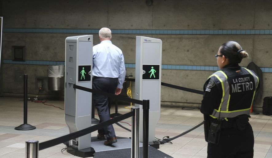 Chris McLaughlin, a vice president with Evolv Technology, test the company's body scanner at Union Station subway station in Los Angeles Wednesday, Aug. 16, 2017. Passengers boarding subway trains in Los Angeles may soon be shuffled through airport-style body scanners that are aimed to detect firearms and explosives. A two-day pilot program by the Los Angeles Metropolitan Transportation Authority, Metro began Wednesday at Union Station. Officials say the machines can scan about 600 people per hour. (AP Photo/Mike Balsamo)