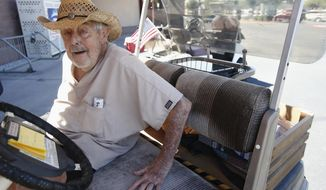 Dr. Charles Thomson, 92, of Sun City, Ariz., gets in his golf cart after talking about his support for President Donald Trump, Wednesday, Aug. 16, 2017, in Sun City, Ariz. (AP Photo/Ross D. Franklin)