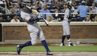 New York Yankees' Aaron Judge hits a home run during the fourth inning of a baseball game against the New York Mets Wednesday, Aug. 16, 2017, in New York. (AP Photo/Frank Franklin II)
