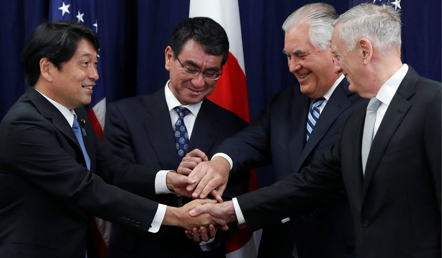 Japanese Defense Minister Itsunori Onodera (left) Japanese Foreign Minister Taro Kono, Secretary of State Rex W. Tillerson, and Defense Secretary James Mattis, gather at the start of acommittee meeting, Thursday at the State Department in Washington. (Associated Press)