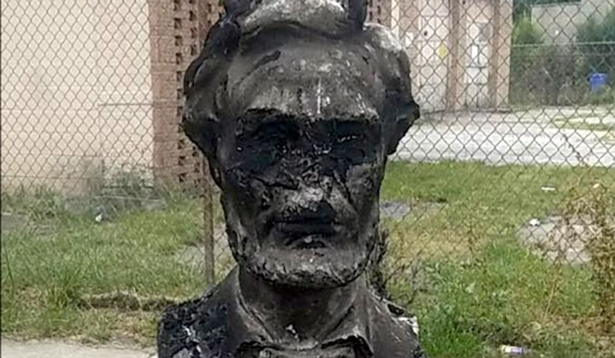 Chicago Alderman Raymond Lopez shared a picture of a charred statue of Abraham Lincoln on Facebook, Aug. 16, 2017. He implored citizens with information to contact his office or the please immediately. (Facebook, Raymond Lopez)