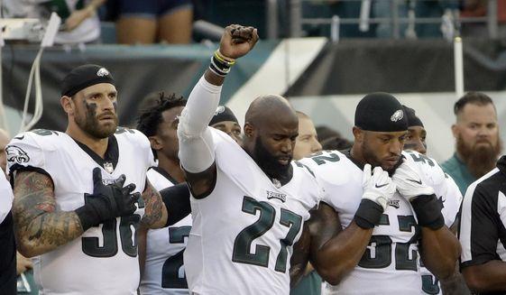 Philadelphia Eagles' Malcolm Jenkins raises his fist during the national anthem before the team's NFL preseason football game against the Buffalo Bills, Thursday, Aug. 17, 2017, in Philadelphia. (AP Photo/Matt Rourke)