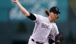 Colorado Rockies starting pitcher Jon Gray throws to an Atlanta Braves batter during the first inning of a baseball game Wednesday, Aug. 16, 2017, in Denver. (AP Photo/David Zalubowski)