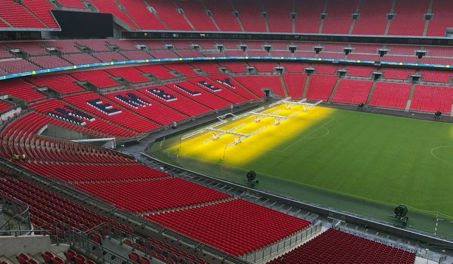 FILE - A Wednesday, Aug. 9, 2017 file photo showing Wembley Stadium in London. The season hadn't even finished when diggers and cranes arrived at White Hart Lane in the middle of May, beginning the summer-long job of demolishing a stadium that Tottenham had turned into a Premier League fortress. It will be another year before the team returns to the site of its famous old ground to take up residence in a new 61,000-seat arena, built with the aim of giving Spurs a better chance of competing with Europe's elite. (AP Photo/Rob Harris, File)