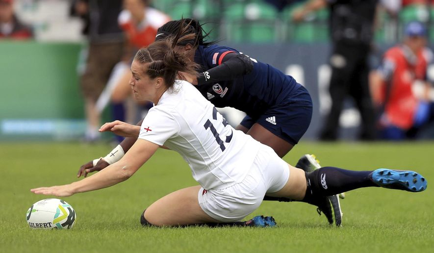 England's Emily Scarratt, front, scores despite a challenge from USA's Cheta Emaba during the 2017 Women's Rugby World Cup, Pool B match at UCD Billings Park, Dublin, Thursday Aug. 17, 2017. (Donall Farmer/PA via AP)