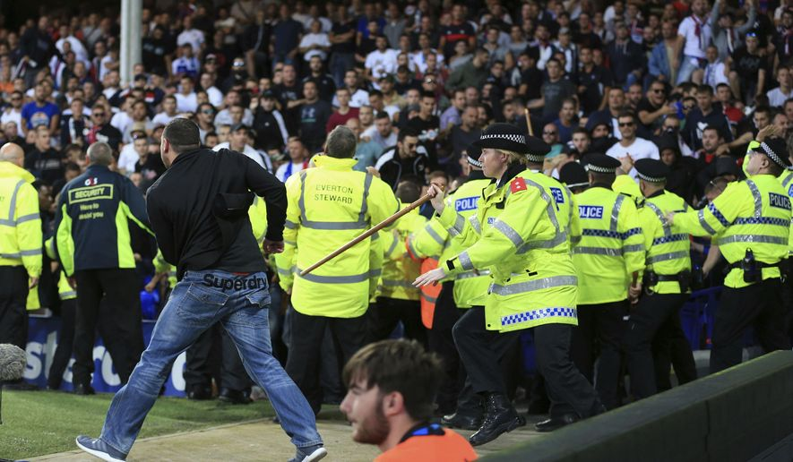 Security close round Hajduk Split fans during the Europa League Play-Off, First Leg soccer match between Everton and Hajduk Split at Goodison Park, Liverpool, England, Thursday, Aug. 17, 2017. (Nigel French/PA via AP)