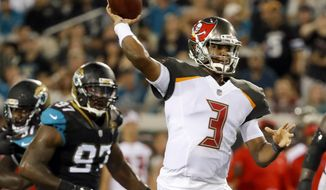 Tampa Bay Buccaneers quarterback Jameis Winston (3) throws a pass as he is pressured by Jacksonville Jaguars defensive lineman Malik Jackson (97) during the first half of an NFL preseason football game, Thursday, Aug. 17, 2017, in Jacksonville, Fla. (AP Photo/Stephen B. Morton)