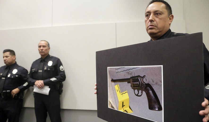 FILE - In this Aug. 10, 2016, file photo, Los Angeles Police officer Lt. Chris Ramirez holds a photo of a gun at a news conference while addressing a case in which a 14-year-old boy was killed by a police officer after the boy had fired on the officer, in Los Angeles. More than 150 people died during encounters with California police last year, the state attorney general's office said Thursday, Aug. 17, 2017. The report by Attorney General Xavier Becerra marks the first time California has released data on police use of force encompassing all 800 of the state's police departments. (AP Photo/Nick Ut, File)