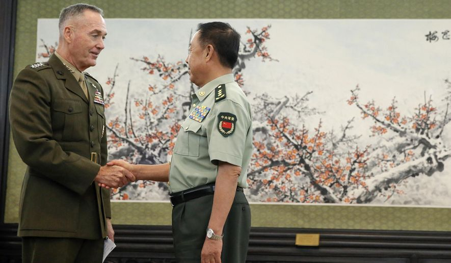 U.S. Chairman of the Joint Chiefs of Staff, Marine Corps Gen. Joseph Dunford, left, shakes hands with China's Central Military Commission Vice Chairman Fan Changlong, at the Bayi Building in Beijing, China, Thursday, Aug. 17, 2017. (Thomas Peter/Pool Photo via AP)