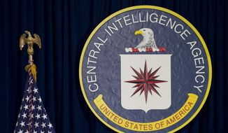 This April 13, 2016, file photo shows the seal of the Central Intelligence Agency at CIA headquarters in Langley, Va. (AP Photo/Carolyn Kaster, File)  ** FILE **