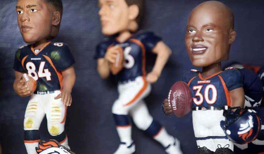 Bobbleheads of former Denver Bronco players, Shannon Sharpe, Bubby Brister, and Terrell Davis sit on a shelf at the home of Rueben and Christine Trujillo in Pueblo West, Colo. on July 27, 2017. (Bryan Kelsen/The Pueblo Chieftain)
