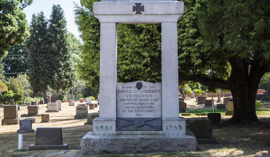 In this Tuesday, Oct. 15, 2017 photo, a memorial for Confederate soldiers sits in Lake View Cemetery on Capitol Hill in Seattle, Wash. In the wake of the violence in Charlottesville, Va., some cities have removed Confederate statues and a Confederate monument on private property in Seattle is causing some tension. Lake View Cemetery closed Wednesday, Aug. 16, 2017, because of the angry messages they've received over the memorial. Steve Ringman/The Seattle Times via AP)