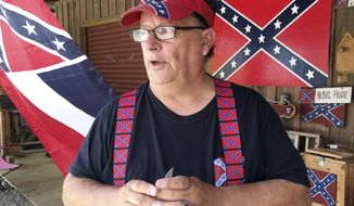 Robert Castello, owner of the Dixie General Store, discusses his dislike of neo-Nazis and the Ku Klux Klan in Chulafinee, Ala., on Thursday, Aug. 17, 2017. Castello and other supporters of Southern heritage fear that extremists are hurting their cause with protests like the rally that turned deadly in Charlottesville, Virginia. (AP Photo/Jay Reeves)