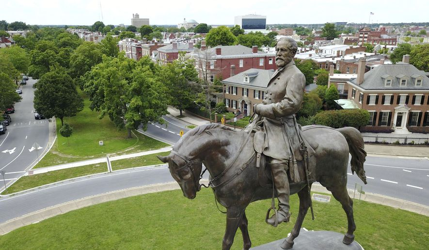 This Tuesday, June 27, 2017, photo shows the statue of Confederate Gen. Robert E. Lee that stands in the middle of a traffic circle on Monument Avenue in Richmond, Va. (AP Photo/Steve Helber)
