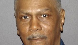 In a photo provided by the Michigan Department of Corrections, Richard Phillips is shown. Phillips, imprisoned 45 years is on the cusp of freedom after another man said he had no role in a 1971 murder in Detroit. A judge last week threw out Phillips' conviction and ordered a new trial. It's not clear if prosecutors will take that step or drop the case. Phillips has declared his innocence for decades. He's been cleared based on the words of Richard Palombo, who was a co-defendant at the 1972 trial. Palombo admitted his role in the shooting during a parole board hearing in 2010, but he insisted that Phillips wasn't present. Four years later, University of Michigan law school learned about Palombo's testimony and successfully reopened the case. (Michigan Department of Corrections via AP)