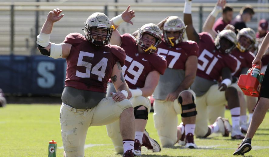 FILE - In this Dec. 27, 2016, file photo, Florida State offensive lineman Alec Eberle (54) stretches during NCAA college football practice, in Fort Lauderdale, Fla. Most who watched Florida State last season thought QB Deondre Francois was the team's toughest players for the hits that he took. It ended up being center Alec Eberle, who kept playing despite two labral tears in his hip. A healthy Eberle could be the key to an offensive line that has struggled the past two seasons.  (AP Photo/Lynne Sladky, File)