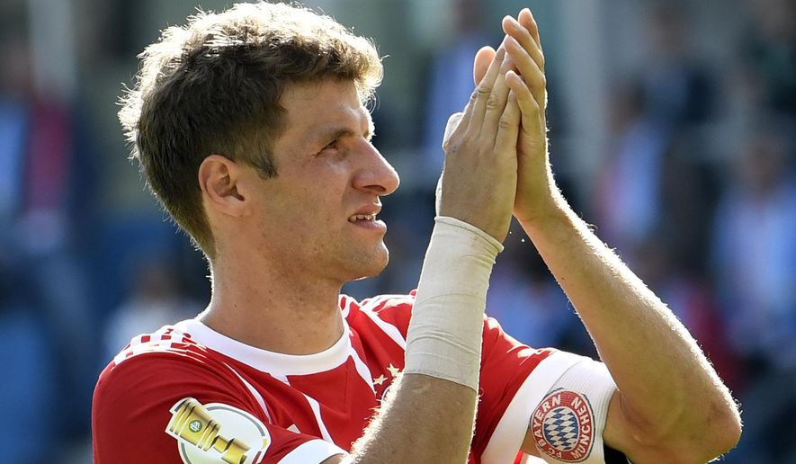 Bayern's Thomas Mueller celebrates after the German soccer cup match between Chemnitzer FC and and FC Bayern Munich in Chemnitz, eastern Germany, Saturday, Aug. 12, 2017. (AP Photo/Jens Meyer)
