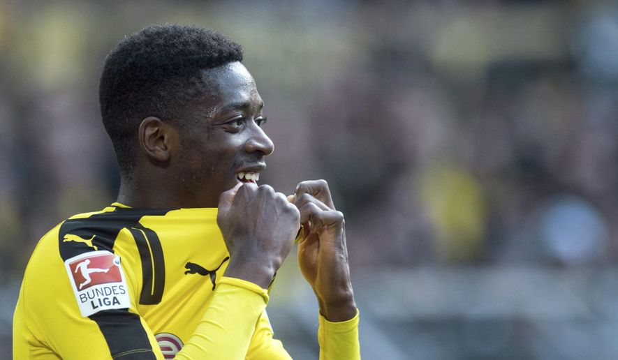 """FILE -  In this April 29 2017 file photo,  Dortmund's Ousmane Dembele attends the Bundesliga soccer match between  Borussia Dortmund and 1. FC Cologne in Dortmund. Borussia Dortmund says Sunday Aug. 13, 2017  France forward Ousmane Dembele remains suspended from team training """"until further notice"""" as he agitates for a move to Barcelona. Dembele has reportedly refused all contact with the club since Barcelona made a bid reported to be worth 105 million euros ($124 million) including add-ons.  (Bernd Thissen/dpa via AP,file)"""
