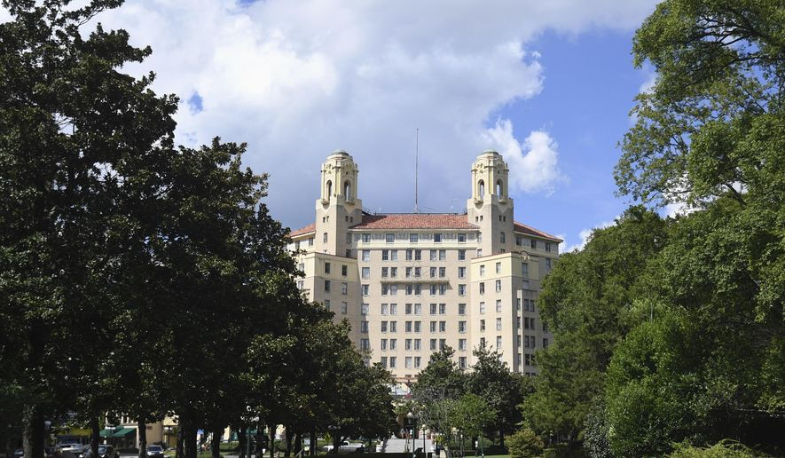 This Wednesday, Aug. 16, 2017, photo shows The Arlington Resort Hotel and Spa in Hot Springs, Ark. The landmark hotel in central Arkansas where one of the world's most famous mobsters frequented is in jeopardy of closing if safety concerns aren't addressed by November. (Mara Kuhn/The Sentinel-Record via AP)