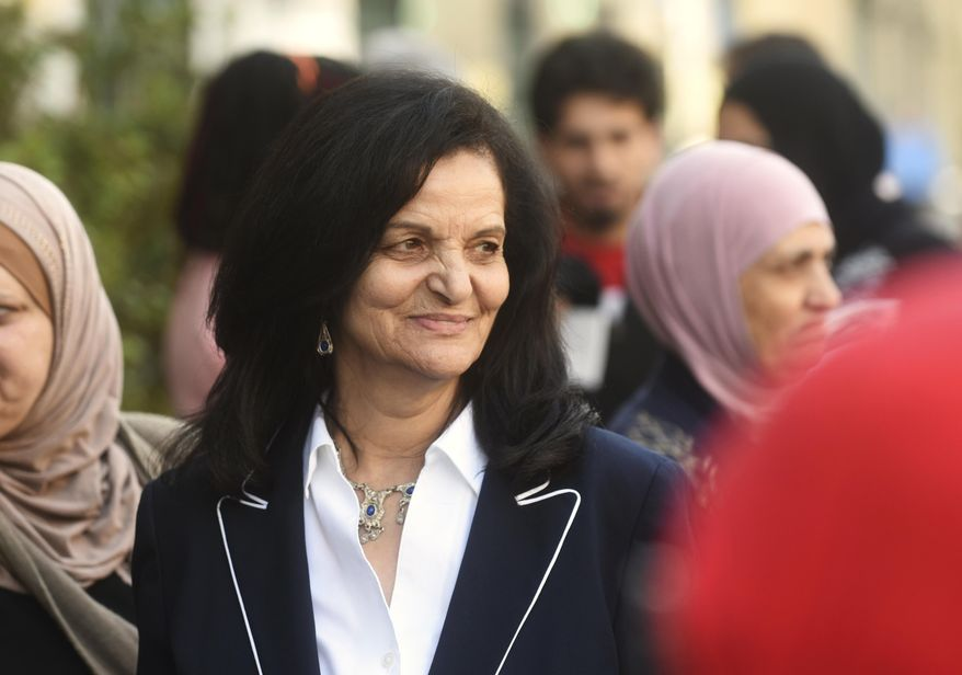 FILE - In this April 25, 2017, file photo, Palestinian activist Rasmea Odeh of Chicago stands outside the Theodore Levin U.S. Courthouse in Detroit. Odeh is returning to Detroit on Thursday, Aug. 17, 2017, for a final court hearing before she's eventually deported for concealing her convictions in two Jerusalem bombings. (Max Ortiz/Detroit News via AP, File)