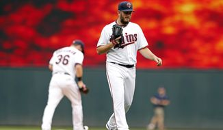 Minnesota Twins pitcher Glen Perkins heads to the mound to pitch for the first time since being on the disabled list for 16 months as he faced the Cleveland Indians in the ninth inning of the first game of a baseball doubleheader Thursday, Aug. 17, 2017, in Minneapolis. The Indians won 9-3. (AP Photo/Jim Mone)