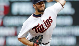 Minnesota Twins pitcher Glen Perkins throws against the Cleveland Indians during the ninth inning in the first baseball game of a doubleheader Thursday, Aug. 17, 2017, in Minneapolis. Perkins  returned to the mound for the first time since being on the disabled list for 16 months. The Indians won 9-3.(AP Photo/Jim Mone)