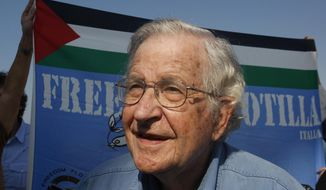 FILE - In this Oct. 20, 2012, file photo. Jewish-American scholar and activist Noam Chomsky stands during a press conference to support the Gaza-bound flotilla in the port of Gaza City. Chomsky is joining the faculty of the University of Arizona this month and will start teaching part-time in 2018. The 88-year-old professor has been a regular guest speaker and has taught at the school for the past five years. (AP Photo/Hatem Moussa, File)