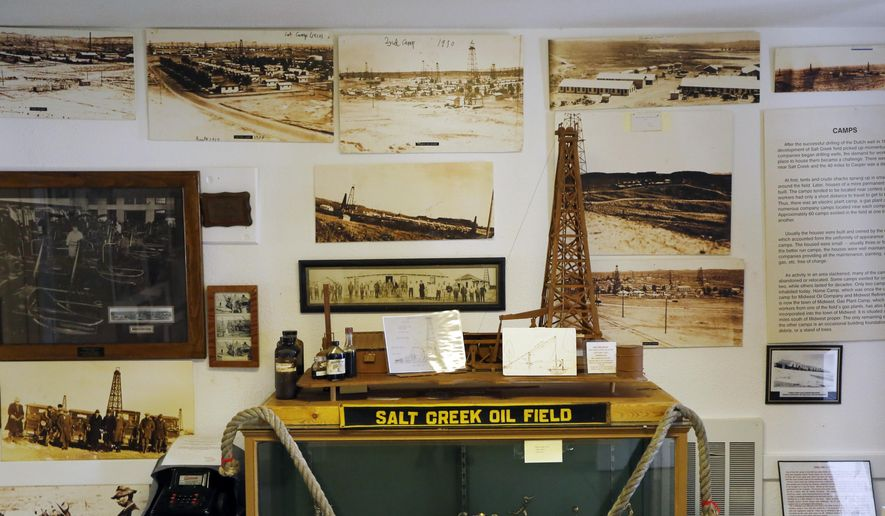 In this Aug. 4, 2017 photo, photographs from the Salt Creek Oil Field boom of the early 1900s cover the walls of the Salt Creek Museum in Midwest, Wyoming. Local resident Pauline Schultz started the museum out of her garage in 1980. (Alan Rogers, Casper Star-Tribune via AP)