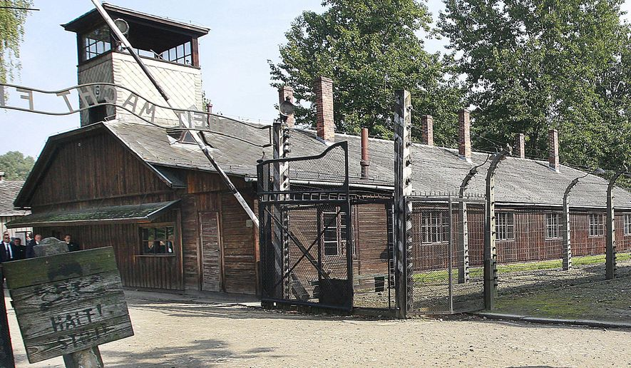 "FILE - This file photo from July 29, 2016, shows the gate of the former German Nazi death camp of Auschwitz in Oswiecim, Poland. The museum and memorial site appears to have weighed in on the debate over U.S. President Donald Trump's response to the outpouring of anti-Semitic and racially charged hatred in Charlottesville, Virginia. The state museum wrote Thursday, Aug. 17, 2017, on Twitter: ""One of the hardest lessons for us today. Perpetrators were people. They accepted an ideology that rationalized and promoted hatred & evil."" (AP Photo/Czarek Sokolowski, File)"