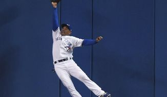 Toronto Blue Jays center fielder Ezequiel Carrera can't make the catch on an RBI double by Tampa Bay Rays' Evan Longoria during the eighth inning of a baseball game in Toronto on Thursday, Aug. 17, 2017. (Nathan Denette/The Canadian Press via AP)