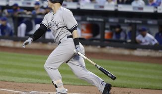 New York Yankees' Tyler Austin watches his single during the first inning of a baseball game against the New York Mets on Thursday, Aug. 17, 2017, in New York. (AP Photo/Frank Franklin II)