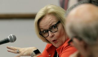 Democratic Sen. Claire McCaskill of Missouri and Republican Sen. Pat Roberts of Kansas talk during a roundtable discussion on agricultural threats Friday, Aug. 18, 2017, in Kansas City, Mo., (AP Photo/Charlie Riedel)