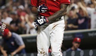 Minnesota Twins' Byron Buxton celebrates his inside-the-park home run off Arizona Diamondbacks pitcher Zack Godley during the fourth inning of a baseball game Friday, Aug. 18, 2017, in Minneapolis. (AP Photo/Jim Mone)