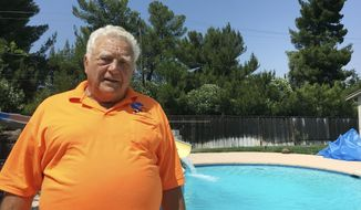Dan Tucker, father of Jared Tucker who was killed in the Barcelona truck attack, stands by the pool in his backyard that was resurfaced by his son Friday, Aug. 18, 2017, in Walnut Creek, Calif. Jared Tucker, a Northern California man who was spending his first wedding anniversary overseas was among those killed in a deadly truck attack in Barcelona, Spain, his family said Friday. Jared Tucker, 42, and his wife, Heidi Nunes-Tucker, were celebrating their honeymoon in Barcelona after saving up for the trip. Jared Tucker worked with his father at a family-owned pool business in the San Francisco Bay Area since he was 16. (AP Photo/Jocelyn Gecker)