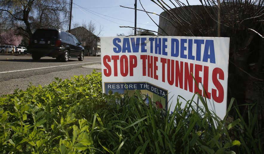 FILE - In this Feb. 23, 2016, file photo, a sign opposing a proposed tunnel plan to ship water through the Sacramento-San Joaquin Delta to Southern California is displayed near Freeport, Calif. Northern California cities and counties are going to court to block what could be the state's costliest water project in history. Stockton on Friday, Aug. 18, 2017, joined Sacramento County in suing the state over Gov. Jerry Brown's plans for two giant water tunnels. The $17 billion tunnels would divert part of the Sacramento River into massive underground pipes for cities and farms to the south and west. (AP Photo/Rich Pedroncelli, File)