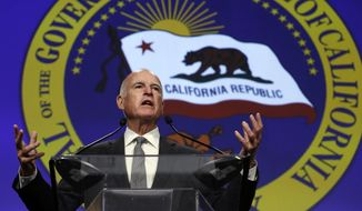 FILE -- In this May 28, 2015 file photo, Gov. Jerry Brown speaks at the annual California Chamber of Commerce Host Breakfast in Sacramento, Calif. On Friday, Aug. 18, 2017, Brown has commuted the lengthy prison sentences of nine inmates serving time for violent crimes, including six people convicted of murder. (AP Photo/Rich Pedroncelli, File)