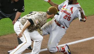 St. Louis Cardinals' Dexter Fowler, right, slides safely into third ahead of the tag by Pittsburgh Pirates third baseman David Freese with a three-run triple, during the seventh inning of a baseball game, Thursday, Aug. 17, 2017, in Pittsburgh. (AP Photo/Keith Srakocic)