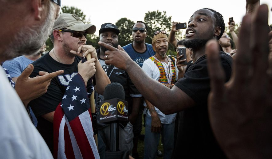 Isaiah Moore, right, argues with counter demonstrators about race relations during a rally in Coolidge Park on Thursday, Aug. 17, 2017, in Chattanooga, Tenn. Organizers said that the purpose of the demonstration, held in response to Saturday's rally by white nationalists in Charlottesville, Va., was to declare resistance against Nazism. (Doug Strickland/Chattanooga Times Free Press via AP) ** FILE **