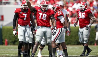 FILE - In this Sept. 10, 2016, file photo, Georgia defensive tackle Trenton Thompson (78) gestures during the second half of the team's NCAA college football game against Nicholls, Saturday, Sept. 10, 2016, in Athens, Ga. Georgia won 26-24. Thompson had offseason shoulder surgery. Then an offseason incident forced the defensive tackle to withdraw from the university for the spring semester, apparently leaving his college career in jeopardy. Now Thompson is back as an important playmaker on Georgia's defensive line. (AP Photo/Brett Davis, File)