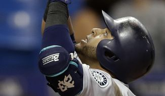 Seattle Mariners' Nelson Cruz celebrates after his home run off Tampa Bay Rays relief pitcher Brad Boxberger during the ninth inning of a baseball game Friday, Aug. 18, 2017, in St. Petersburg, Fla. (AP Photo/Chris O'Meara)