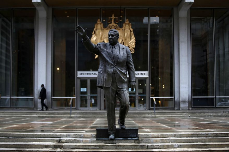 """Shown is a statue of the late Philadelphia Mayor Frank Rizzo outside the Municipal Services Building in Philadelphia, Friday, Aug. 18, 2017.  Workers have removed the words """"black power"""" that were spray painted across the statue of the former Philadelphia mayor and police commissioner. Rizzo critics say he reigned over the city when police brutality was the accepted norm and many want the statue removed.  (AP Photo/Matt Rourke)"""