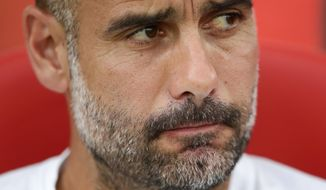 Manchester City's head coach Pep Guardiola looks on prior of the Costa Brava trophy friendly soccer match between Girona and Manchester City at the Montilivi stadium in Girona, Spain, Tuesday, Aug. 15, 2017. (AP Photo/Manu Fernandez)
