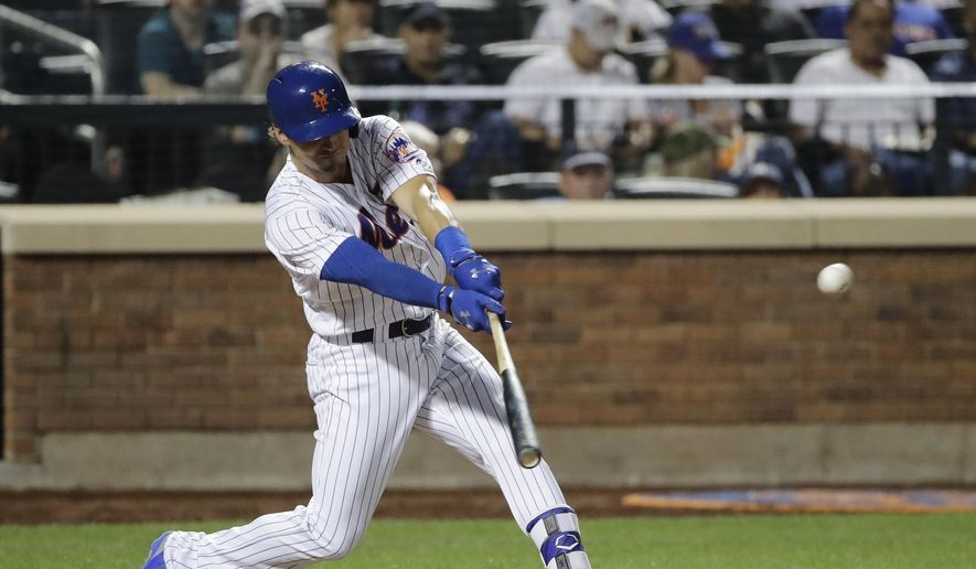 New York Mets Matt Reynolds hits an RBI single during the seventh inning of a baseball game against the New York Yankees on Thursday, Aug. 17, 2017, in New York. (AP Photo/Frank Franklin II) **FILE**
