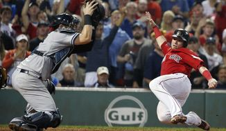 Boston Red Sox's Christian Vazquez, right, scores as the throw goes by New York Yankees' Austin Romine on a two-run single by Jackie Bradley Jr. during the eighth inning of a baseball game, Friday, Aug. 18, 2017, in Boston. (AP Photo/Michael Dwyer)