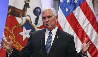 In this Aug. 16, 2017, file photo, Vice President Mike Pence takes part in a joint statement with the Chilean president at La Moneda government palace, in Santiago, Chile. (AP Photo/Esteban Felix) ** FILE **