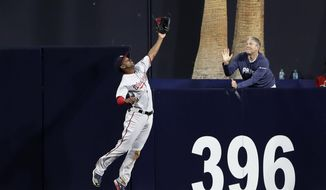 Washington Nationals center fielder Michael Taylor makes the catch for the out on San Diego Padres' Yangervis Solarte during the second inning of a baseball game Friday, Aug. 18, 2017, in San Diego. (AP Photo/Gregory Bull)