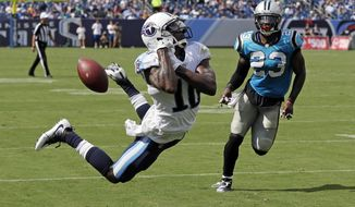 Tennessee Titans wide receiver Tre McBride (10) cannot hold onto a pass in the end zone as he is defended by defensive back L.J. McCray (23) in the first half of an NFL football preseason game Saturday, Aug. 19, 2017, in Nashville, Tenn. (AP Photo/James Kenney)