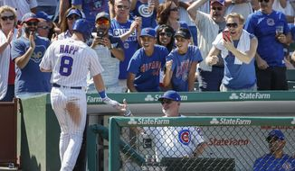 Chicago Cubs' Ian Happ, left, celebrates with manager Joe Maddon after hitting a solo home run off Toronto Blue Jays' Nick Tepesch during the fourth inning of a baseball game, Saturday, Aug. 19, 2017, in Chicago. (AP Photo/Kamil Krzaczynski)